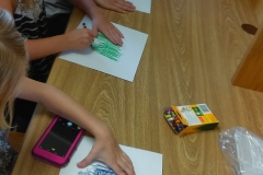 2017 07 26 13 G, E, and J work on animal rubbings